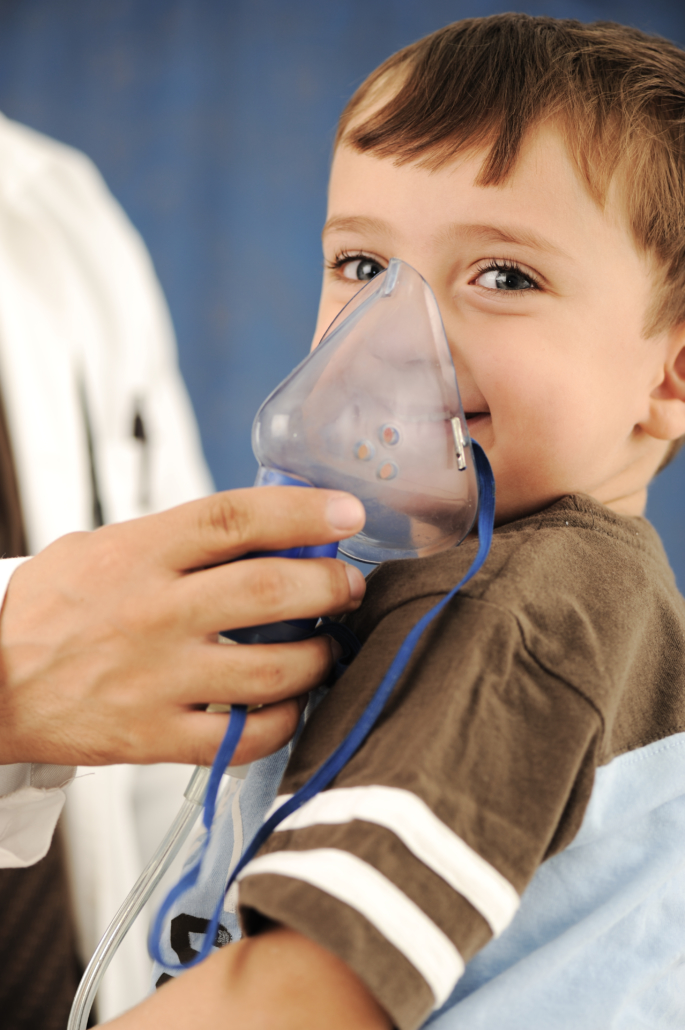 Doctor, child, inhaler mask for breathing, hospital