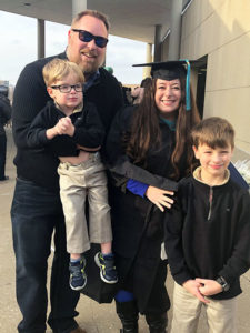 Elizabeth Lewis with family at her graduation